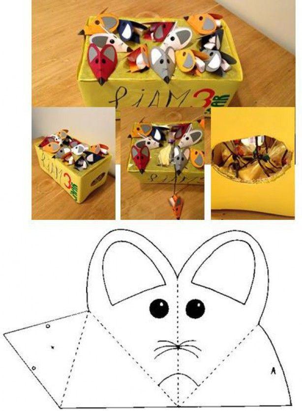 Kartonnen doos als 'kaas'. Kartonnen muisjes met een dropveterstaart en gevuld met spekjes. De muisjes liggen op de doos met het staartje door een gaatje in het papier. Aan het staartje zitten zakjes met stukjes kaas. Gemaakt voor de 3e verjaardag van mijn zoon als traktatie op het kinderdagverblijf.