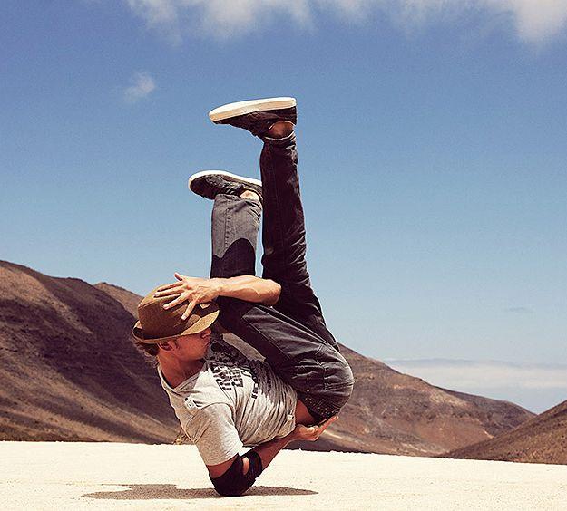 Breakdancer on one elbow, environmental portrait of alternative athlete