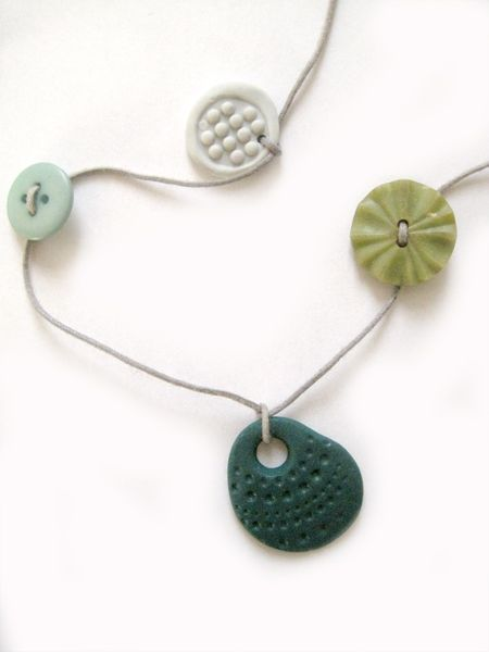 Necklaces of handmade beads and vintage buttons by Van San