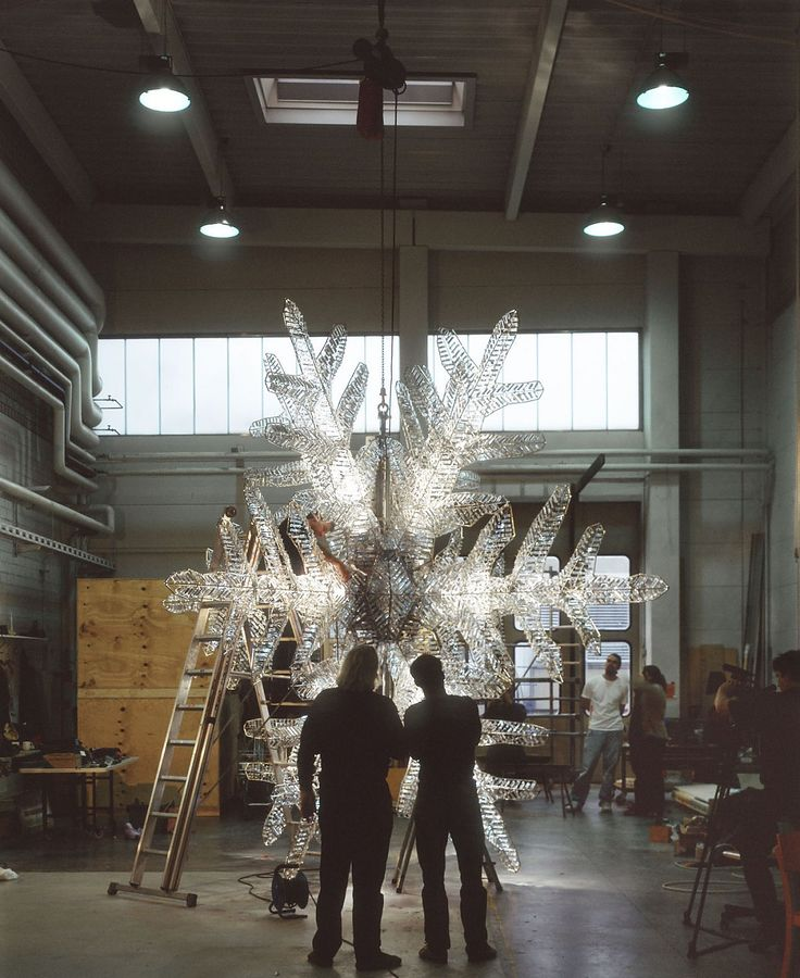 """UNICEF Crystal Snowflake NEW YORK, 2004 Ingo Maurer's Snowflake for New York's holiday season graces the intersection of Fifth Avenue and 57th Street in Mid-Manhattan since 2004. The handcrafted object of stainless steel, crystal prisms and lighting fixtures shines as a """"beacon of hope, peace and compassion for vulnerable children around the world"""" (UNICEF)."""