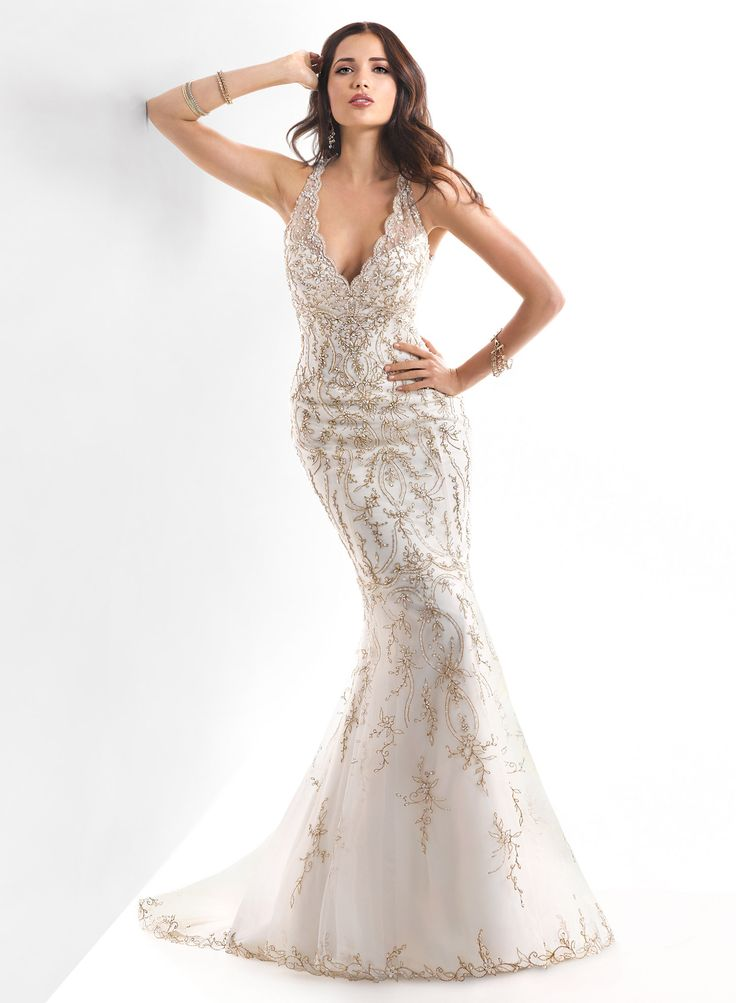 Maggie Sottero Blakely. Fully beaded Art Deco inspired fit and flare gown with straps and illusion back. TheBridalCollection.com