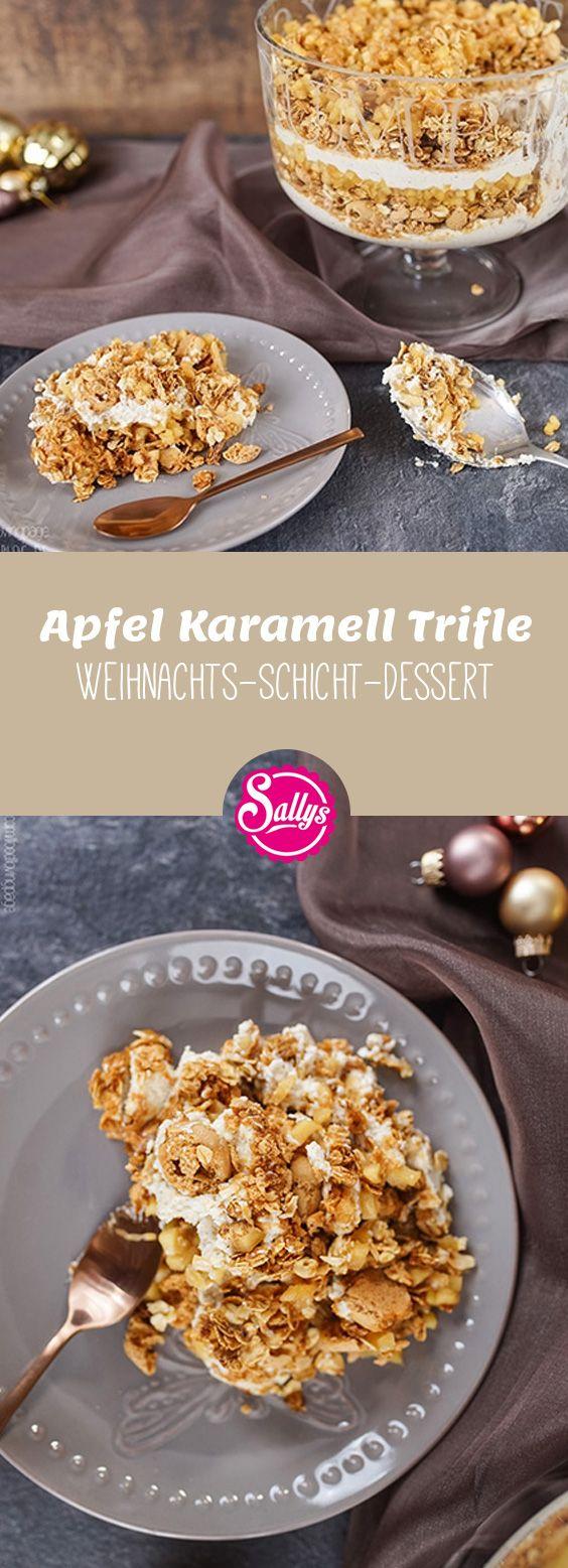 Dieses Trifle besteht aus verschiedenen Komponenten: Haferflocken Granola und Amarettini Keksen, einer Vanille-Zimt-Creme, einem Apfelkompott und einer Karamellsoße.