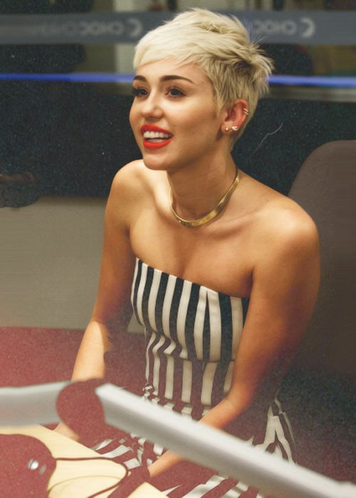 I hate Miley Cyrus but her hair here is really cute. Maybe go a little shorter on my left side like this and keep the right longer