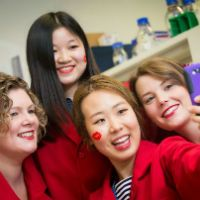 Kissing goodbye to MS. L-R Kylie Magee, Pei Mun Aui. Min Kim, Melissa Biemond on Red Lab Coat Day - raising awareness for Multiple Sclerosis research and fundraising. http://www.med.monash.edu.au/news/2015/kissing-goodbye-to-ms.html