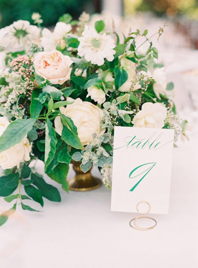 Lush natural looking garden inspired centrepieces at a classic elegant outdoor wedding reception | simple script table numbers in gold place card holders | English Garden Style Wedding in California