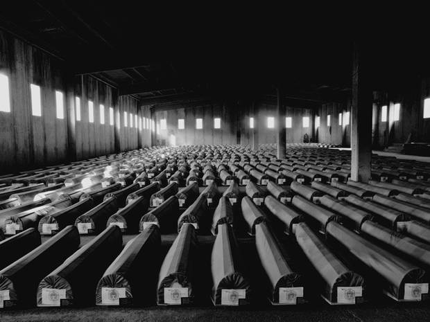 Battery factory in Potočari; 600 coffins, victims of the Srebrenica massacre await burial