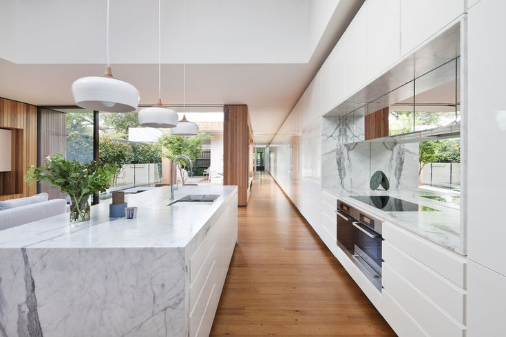 Gallery | Australian Interior Design Awards. Key features - play of materials & textures, timber, marble, white laminate, metal -repetition of timber on the walls and flooring