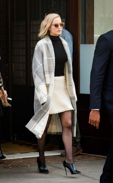 Jennifer Lawrence completed her stylish cold-weather ensemble with a monochrome tweed coat.