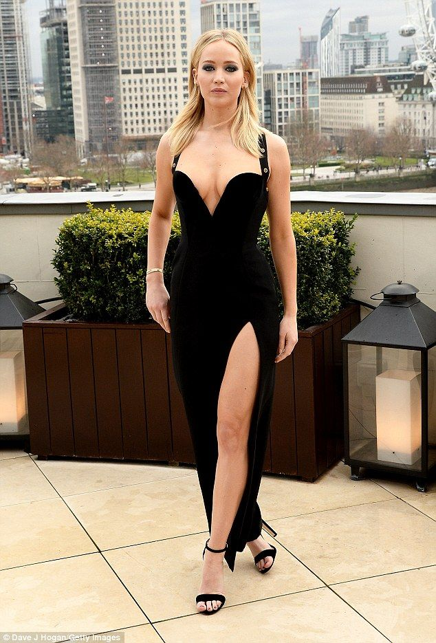 Sizzling:Jennifer Lawrence appeared keen to court the same incredible attention as Elizabeth Hurley Safety Pin dress on Tuesday afternoon as she stole the English actress' style while appearing at a Red Sparrow photocall at the Corinthia Hotel in London