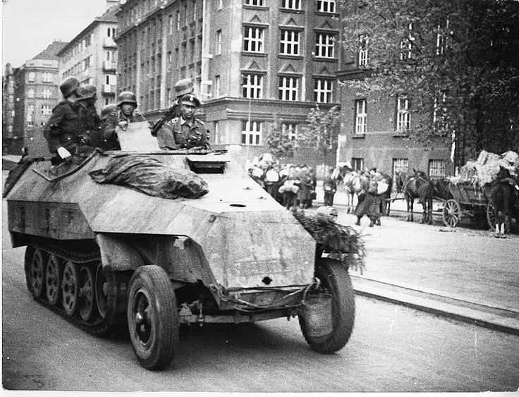 These is a photo of the W-SS pulling out of Prague during the Prague Uprising in May '45. Note the corpse on the bonnet of the SdKfz, and the PzGren anxiously scanning the buildings for snipers.