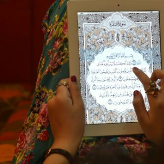 QURAN  and i like the skirt <3