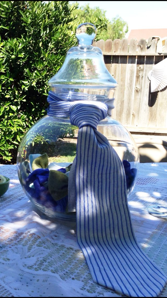 Lil man baby shower centerpiece idea, it's a boy...ask everyone to bring a pair of baby booties/socks to add to the jar!!!