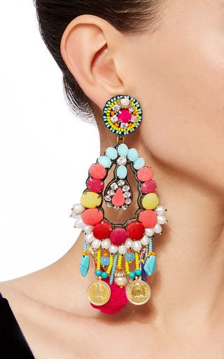 These **Ranjana Khan** earrings feature an open tear drop shape with chiffon covered crystals, turquoise and pom pom fringe, and pearl accents.