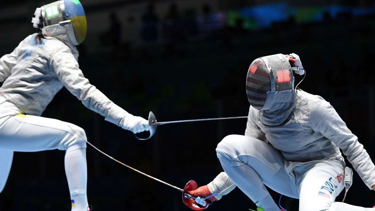 Fencing: Ibtihaj Muhammad of the United States, right, competes against Olena Kravatska of Ukraine during women's sabre individual competition in the Rio 2016 Summer Olympic Games at Carioca Arena 3.
