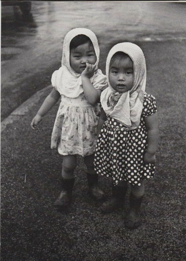 Ken Domon, The Children of Chikuho (a coal mining town in Japan). Two small dirty girls in boots and kerchiefs.