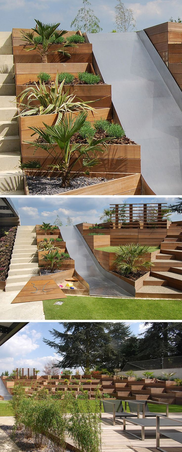 This backyard with a slide, makes use of triangular wooden planters to deal with the slope of the yard.