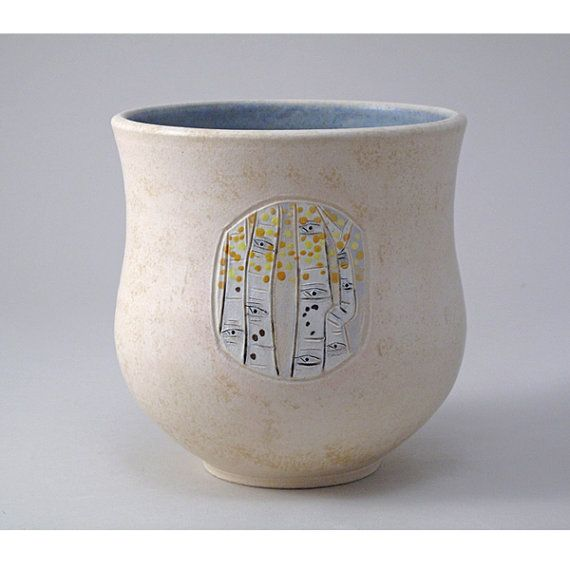 Original work by Jamie E. Hatch. Stoneware, wheel-thrown vase with carved aspen embellishments.
