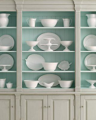 I love this hutch! I want to paint the inside of my hutch this colour. Dishes show up so beautifully like this.