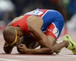 Dominican Republic's Felix Sanchez kisses a photo after he won the men's 400m hurdles final at the London 2012 Olympic Games at the Olympic Stadium
