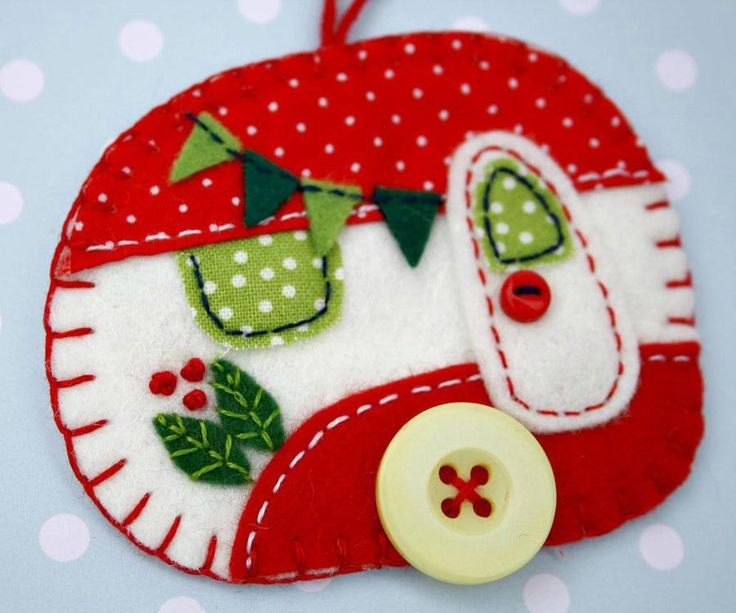 Vintage caravan trailer hanging ornament, handmade from felt and decorated with fabric scraps. With tiny felt bunting and buttons for the wheel and door knob.Co