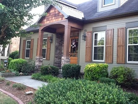 After: Paint, porch, cedar/ stone columns, cedar shutters, bronze metal roof, and gutters