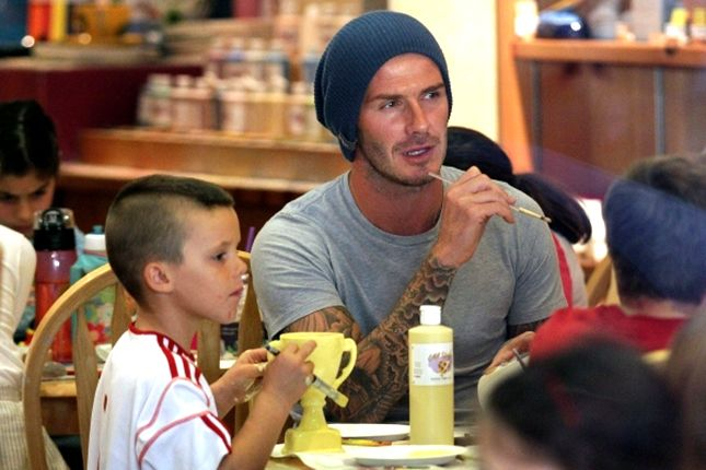 David Beckham painting pottery with his kiddies