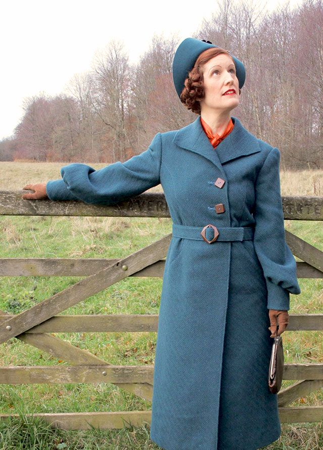 1930s winter coat in textured teal wool and brown buttons and buckle