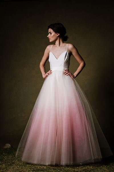 This ombre pink dip-dyed tulle wedding dress is so beautiful. This is the perfect source of inspiration for brides who are looking for their wedding gown.