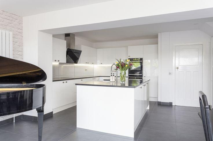 beautiful white gloss solent kitchen with island  kitchen