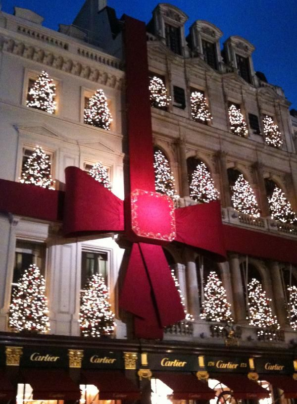 Cartier - all wrapped up with a bow... but lets not overlook the lit trees in each window!!! This is how you decorate your store for the holidays!!! #christmas