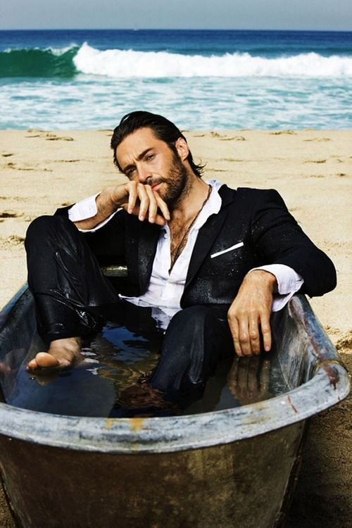 Hugh Jackman. Now, why do I need a soaking wet hero in a tub? Because surely I must...