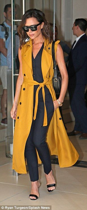 Not-so mellow yellow! Turning heads in an eye-catching mustard trench coat, the 43-year-old fashion designer looked flirty and fashionable as she ran errands in the city