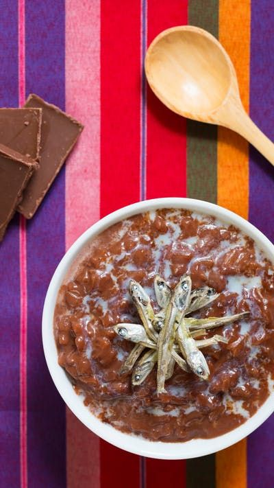 Wake up to this sweet and savory chocolate rice porridge, topped with a special ingredient.