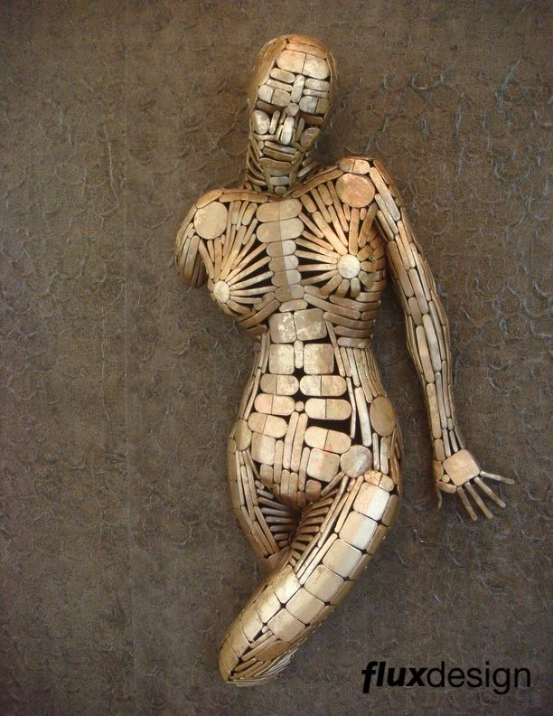 Flux Design,figurative metal wall mounted sculptures,female steel sculpture,steel punch outs sculpture,nude steel metal figure sculpture,Jesse Meyer,sculpture studio,Milwaukee wi