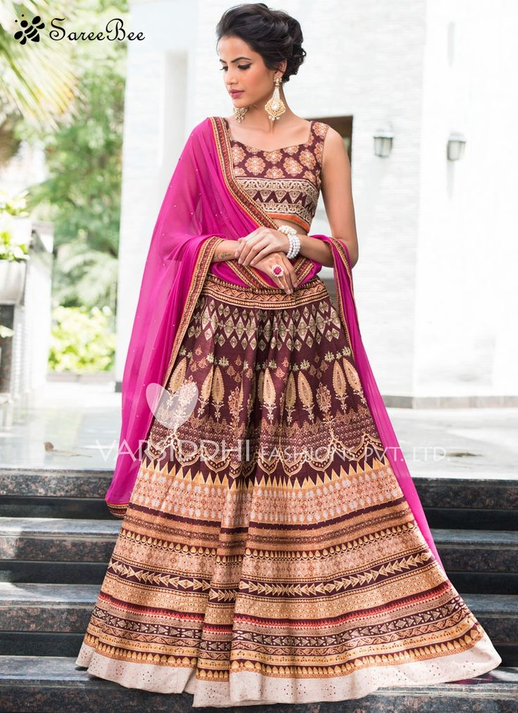 Exotic Lace Work Art Silk Lehenga Choli  This multi colour art silk lehenga choli is adding the wonderful glamorous showing the sense of cute and graceful. Beautified with lace and print work all synchronized very well with all the design and style of the dress. Comes with matching choli and dupatta.