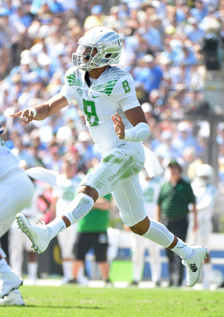 Marcus Mariota #8 of the Oregon Ducks throws on the run during the first quarter against the UCLA Bruins at Rose Bowl on October 11, 2014 in Pasadena, California.