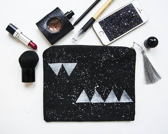 Triangles & stars hand painted cotton zipper pouch. This medium size makeup bag/pencil case is perfect to fit some cosmetics, credit cards, documents, earbuds, pencils or keys and more.  Made from black cotton canvas with triangles and constellation pattern painted/stamped with water based