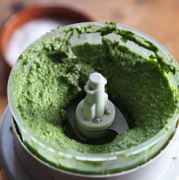 In this classic version of pesto, the basil leaves are blanched in boiling water, then quickly shocked in ice water, to give the sauce a brilliant green hue.
