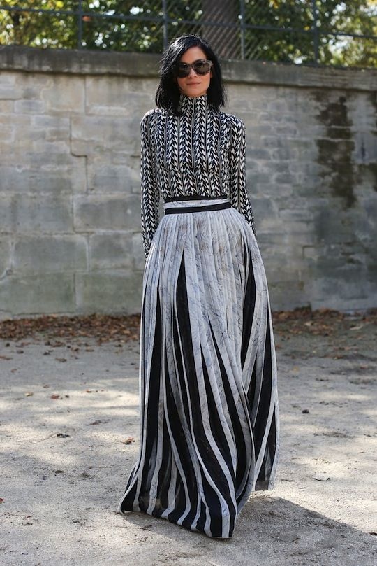 Favorite Street Style Snaps from Paris Fashion Week: Leigh Lezark is a total show stopper in this floor-length getup. Girl looks gooood.