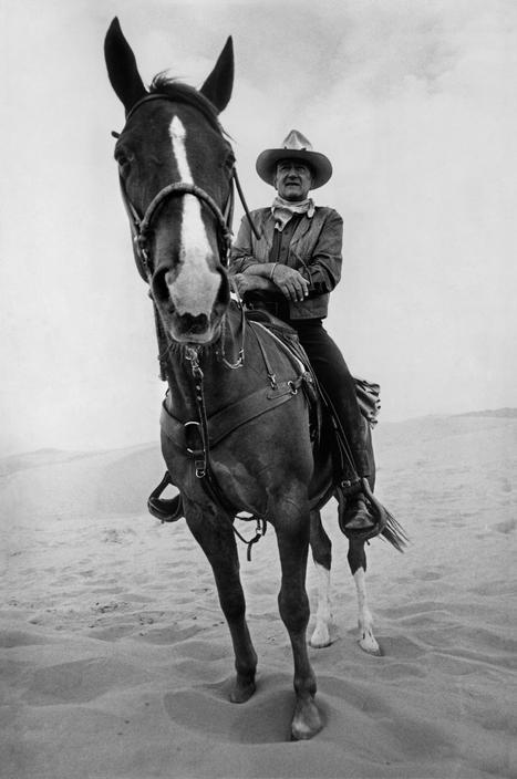 Raymond Depardon. Durango desert. Mexico. US actor John Wayne on a western movie set. 1972.