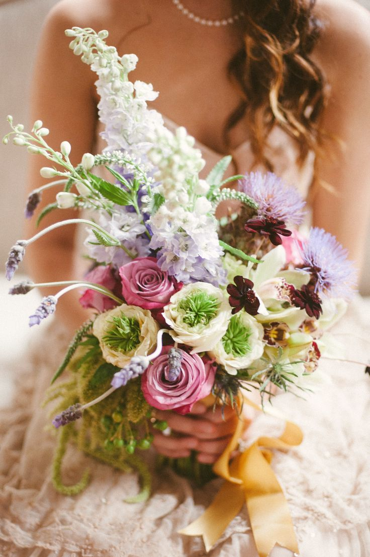 Whimsical #Bouquet! | See more wedding inspiration on http://www.StyleMePretty.com/florida-weddings/pensacola/2014/01/14/romantic-wedding-inspiration-at-the-belmont-center/ Jessi Field Photography