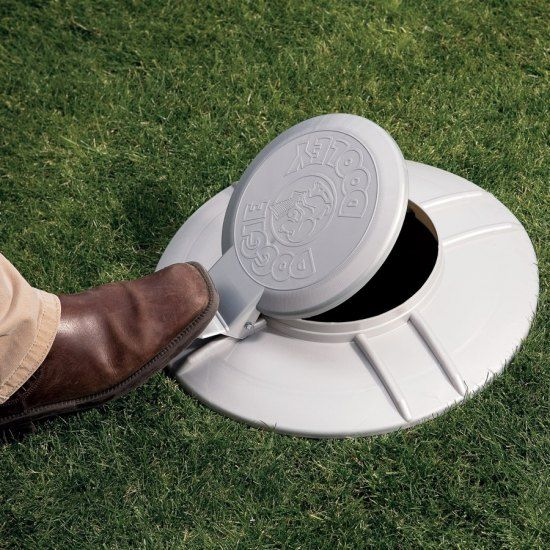 Doggie Dooley - Mini septic system for your dog. Use the included shovel to scoop your dog's waste into the tank.