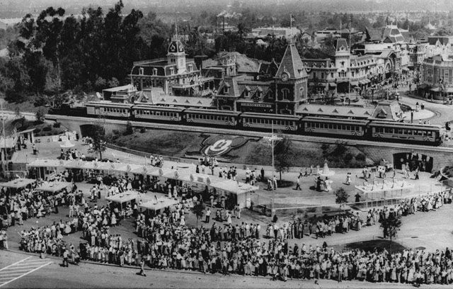 Hundreds of people wait in line for tickets to Walt Disney's $17 million amusement park called Disneyland on July 18, 1955. The Disneyland and Santa Fe train which circles the park is stopped at the Disneyland entrance. (Los Angeles Times/AP Photo)