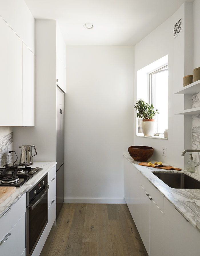 Modern Brooklyn apartment kitchen with Ikea cabinets and small scale appliances