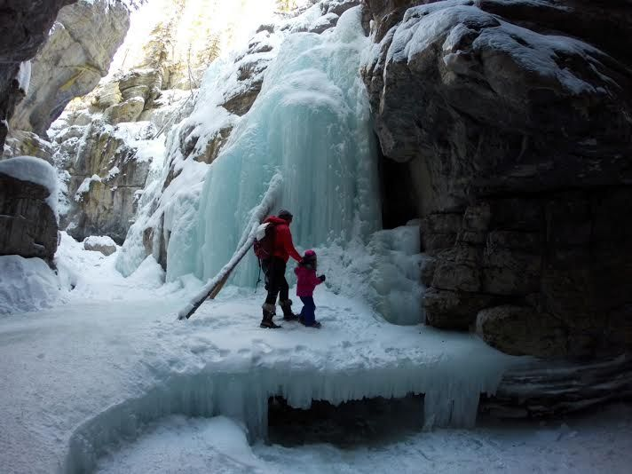 Mother and Daughter Explore Ice Caves