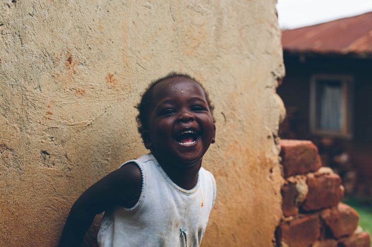 Ugandan girl. Oh this smile!
