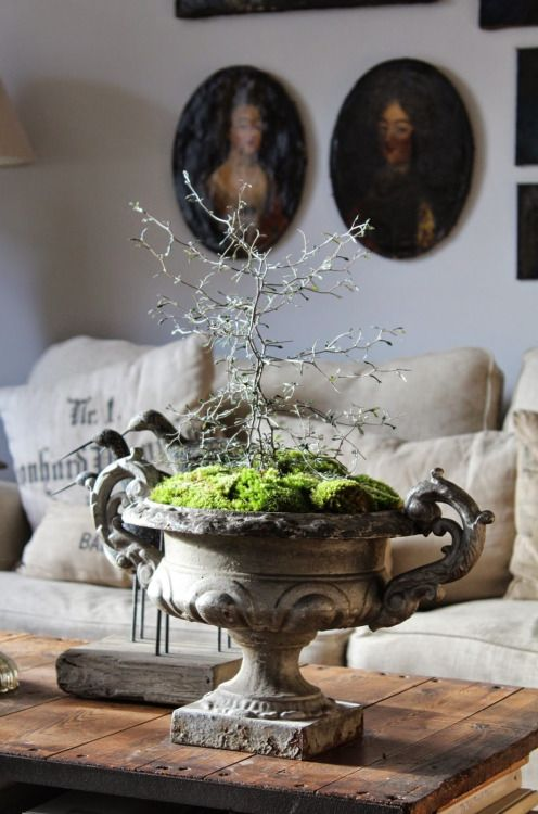 Bring a rustic outdoors look in by using an urn meant for outdoor use