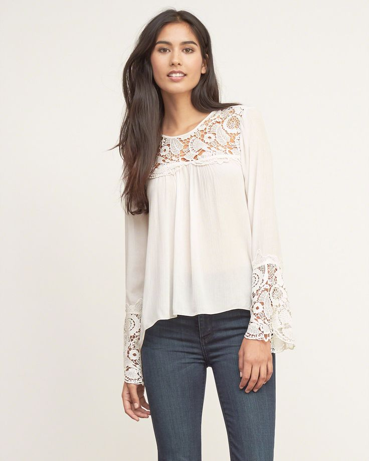 Womens Cutwork Peasant Blouse | Lightweight with a crew neck and curved hi-lo hem, cutwork detailing around neckline and sleeves, Easy Fit | Abercrombie.com