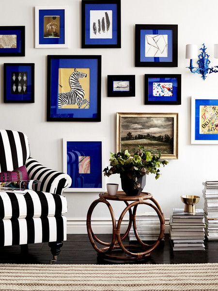 Revive a tired gallery wall and add personality with colored mats