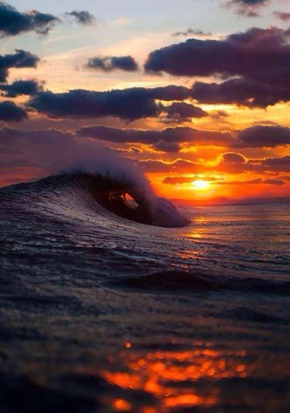 Waves crushing during sunset